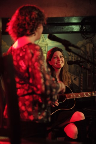 Amy Nelson looks at Cathy Guthrie during their show at The Continental Club in Austin, Texas, on Thursday, Jan. 21, 2016. Together, Nelson and Guthrie make up Folk Uke.